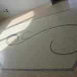 Immagine che ritrae una decorazione in mosaico su pavimento alla veneziana a Rovigo